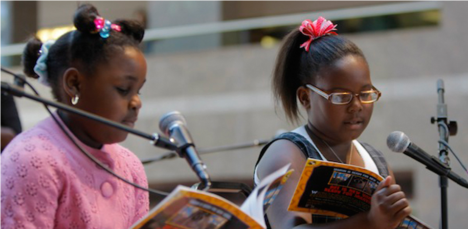 2 readers at an event for the Brooke Jackman Foundation